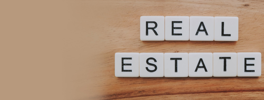 Scrabble tiles form the words real estate